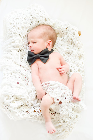 newborn boy wearing bow tie Stock Photo - 27628421