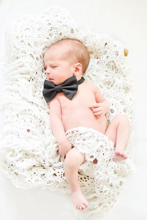 newborn boy wearing bow tie Stock Photo - 27628421
