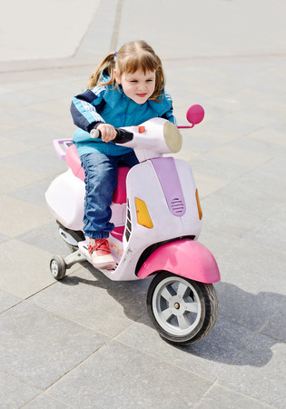 little girl ride a motorcycle photo