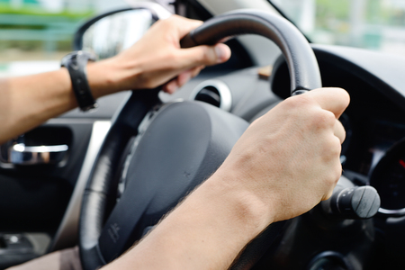 man hands  holding black wheel  photo