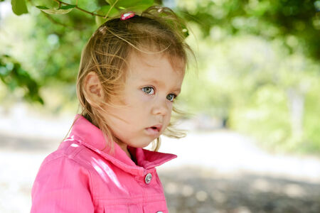 toddler girl outdoors in windy weather Stock Photo - 27792228
