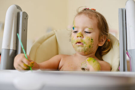 dirty toddler girl  drawing  everywhere Stock Photo - 27792229