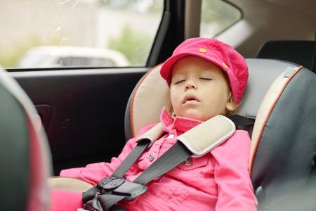 toddler girl sleeping in car seat Stock Photo - 27792230
