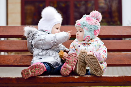 baby friends sitting on the bench Stock Photo - 27792221