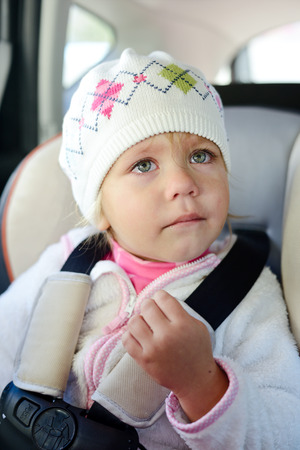 car seat: toddler girl crying in car seat
