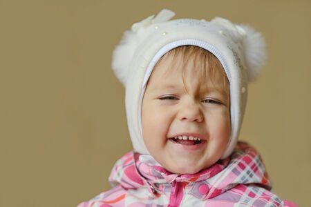 happy toddler girl wearing winter clothing photo