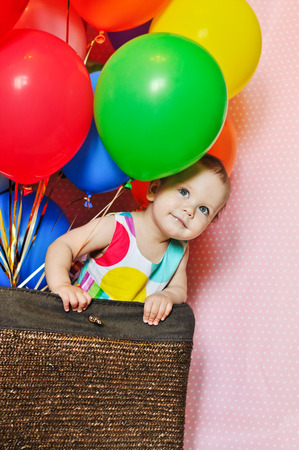 birthday one year old girl with balloons photo