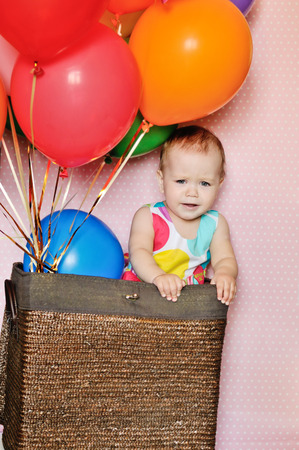funny birthday girl with balloons photo