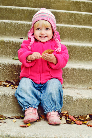 sweet toddler girl in fall time photo