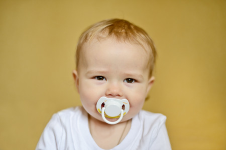 happy baby  with pacifier in soft selective focus