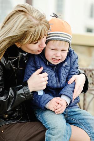 mother calming  down toddler son photo