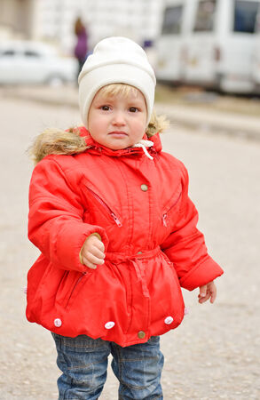 sad sweet toddler girl outdoors photo