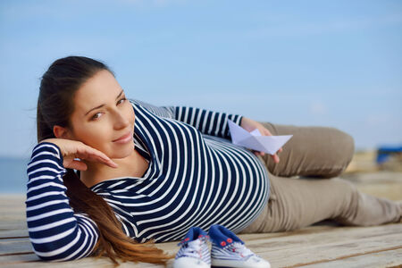 beautiful pregnant woman on the sea coast photo