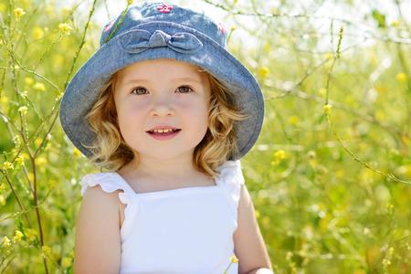 cute babies: happy toddler girl in rape field