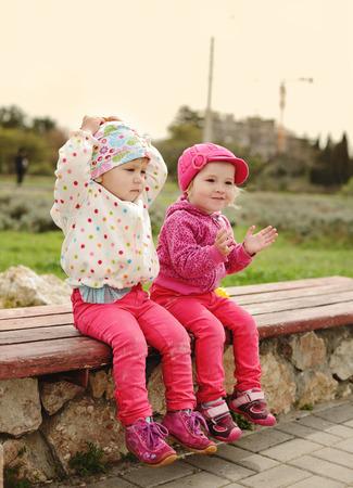 two toddler girls having  fun photo