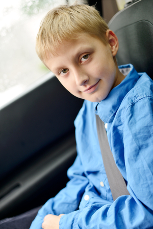 10 years old: 10 years old boy in car with belt