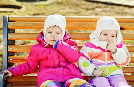 toddler friends sitting on the bench photo