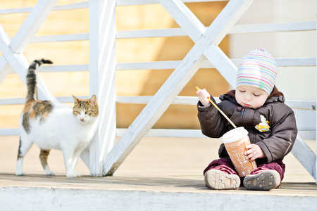 baby boy and cat on the walk photo