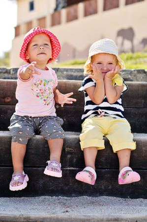 two summer baby friends having fun photo