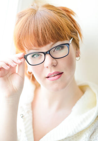 redhead young woman with glasses photo