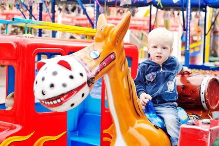 Little boy in the amusement park photo