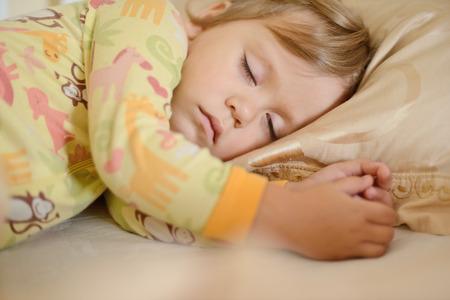 sleeping toddler girl wearing pajama photo