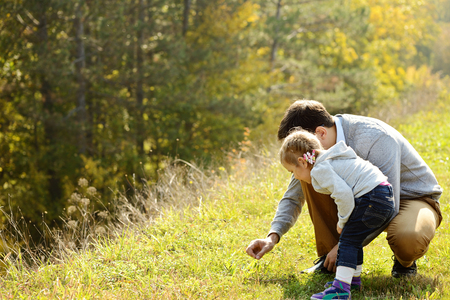 father introducing toddler daughter to the world of nature photo