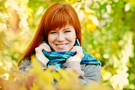 redhead young woman in fall photo