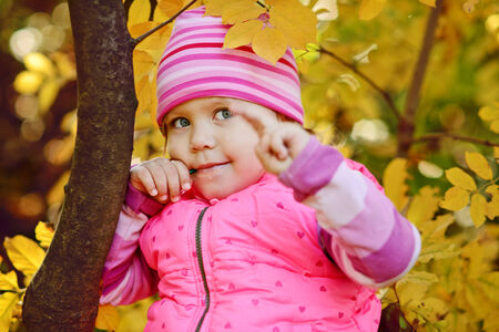 happy child with lollipop in bright fall time Stock Photo - 29559288