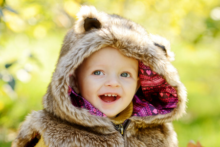 the lovely boy: funny baby boy outdoors wearing fur costume