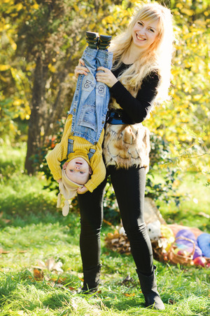 fun of mother and baby son in fall photo