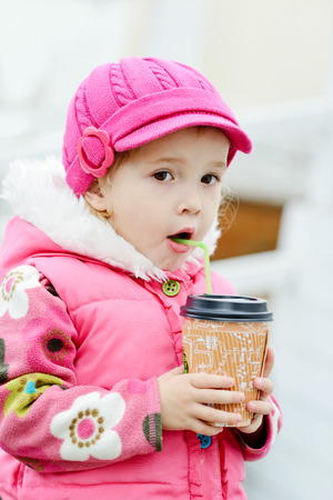 tiddler: tiddler girl with hot drink on the street