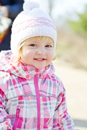 seasonal clothes: portrait of toddler girl wearing winter clothing Stock Photo