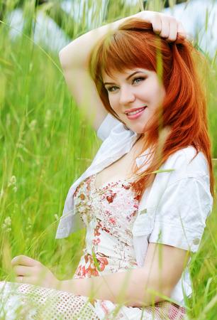 redhead   girl resting in grass photo