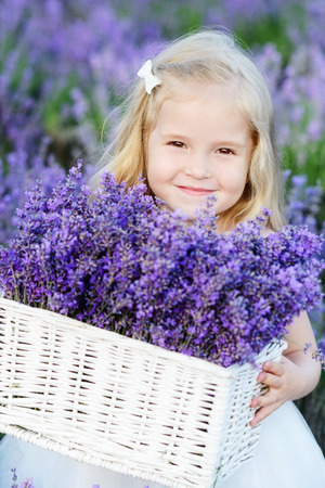 Smiling girl  is in a lavender field photo