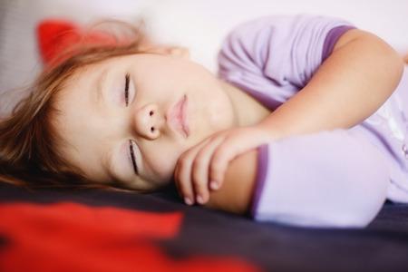sleeping toddler girl wearing pajama