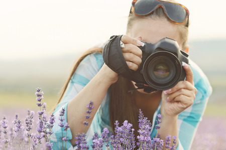 woman with camera in the field photo