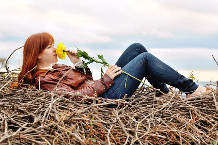 redhead girl with autumn flower photo