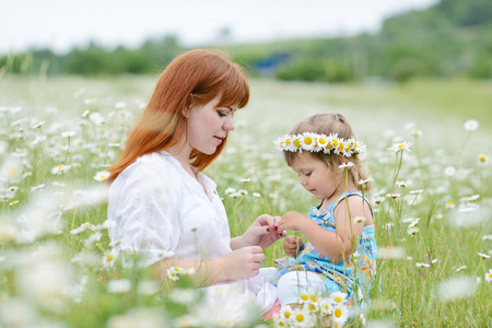 fun in field of daisies photo