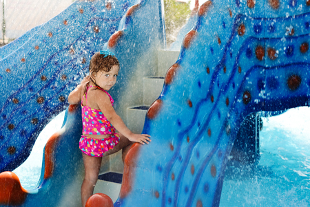 cute toddler girl in aqua park photo