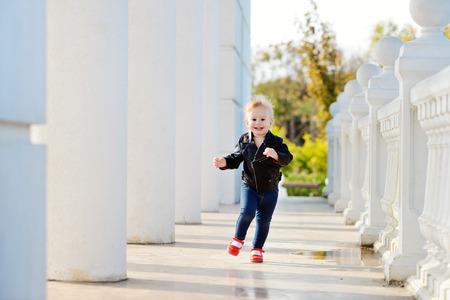 running baby girl in motion photo