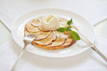 short crust pastry: apple pie with ice cream, soft selective focus
