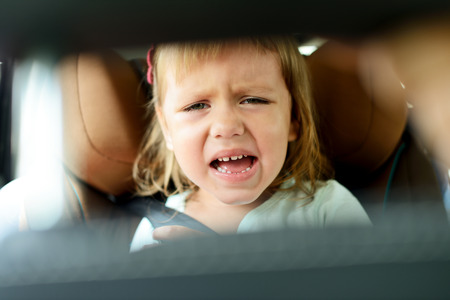 buckled: toddler girl crying in car