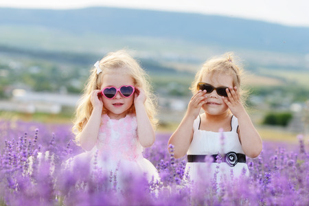 two friends in field wearing sunglasses photo