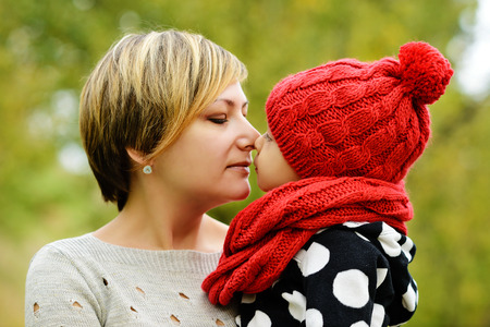 cradling: Closeup portrait of mother and daughter