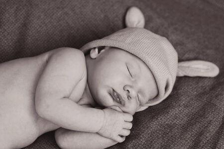 sleeping  newborn wearing bunny hat photo