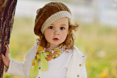 cute baby girl in fall time Stock Photo