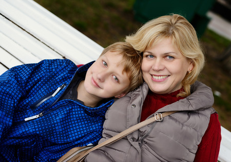 middle age woman and son outdoors photo