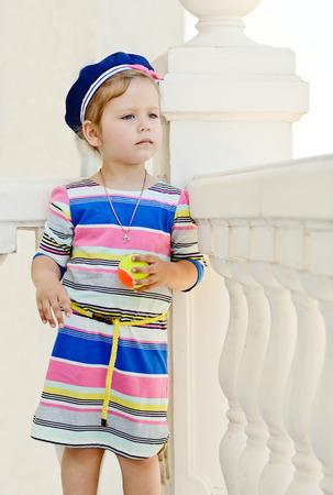 sailor girl: little sailor girl standing near the columns