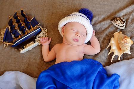 newborn boy wearing sailor hat photo